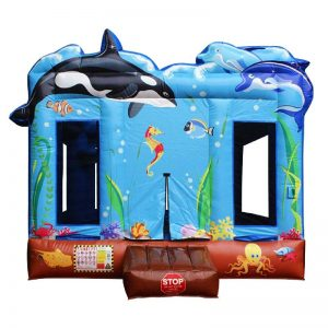 Blue and brown sea themed bounce house featuring an orca whale and two dolphins.