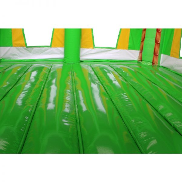 Green and yellow bouncy castle jumping area.
