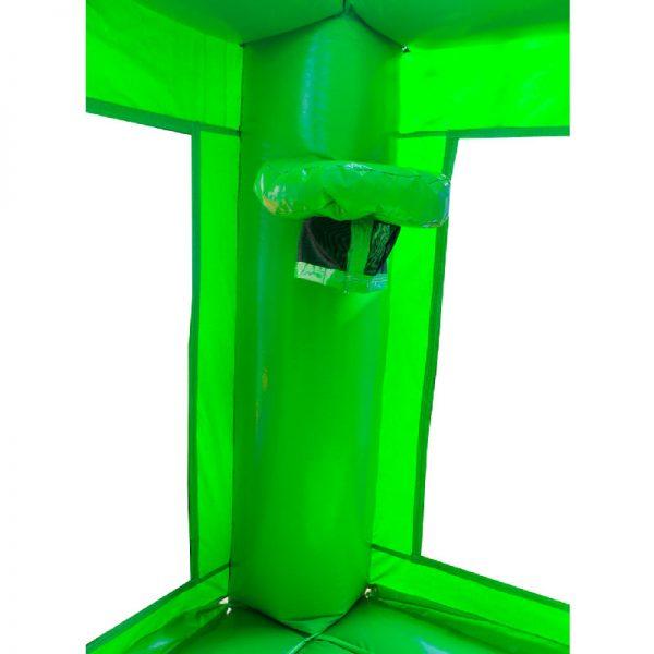 Green bounce house basketball hoop on the corner column.