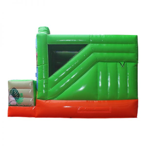Side view of a green and orange Dino themed inflatable.