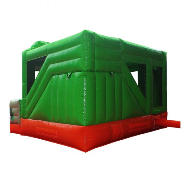Rear view of a green and orange Dino themed inflatable.