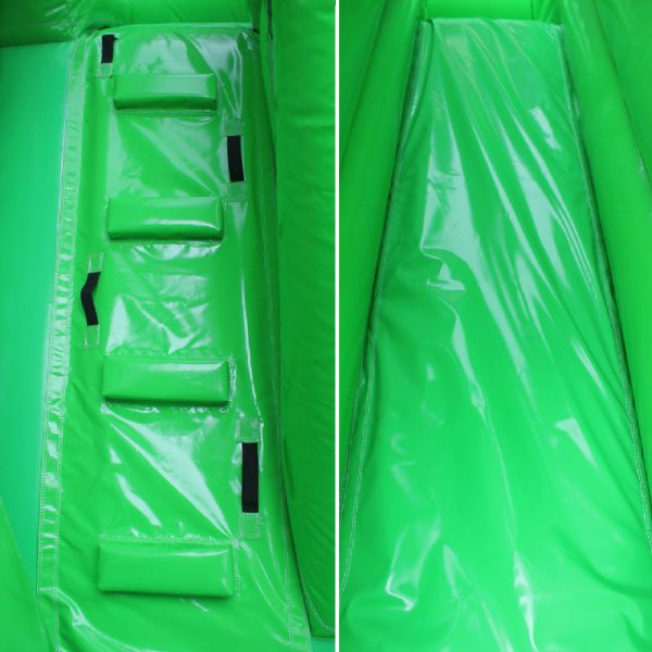 Closeup of a green bouncy castle climbing wall and a slide.