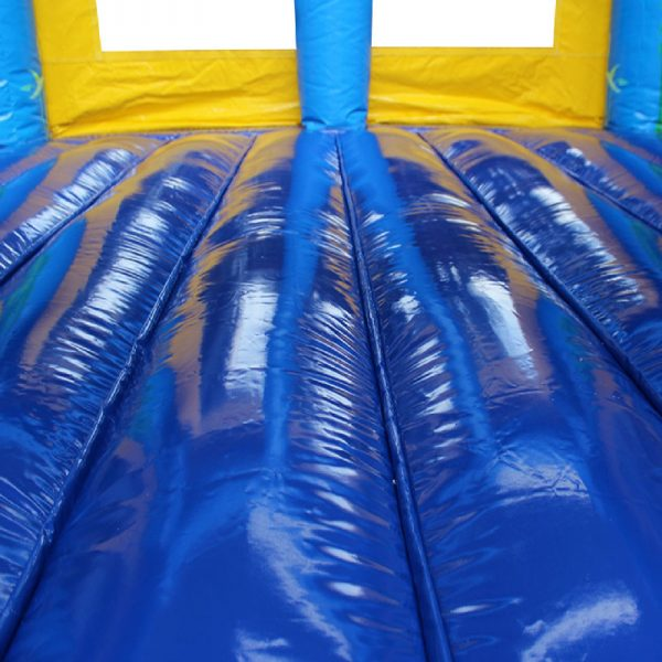 Blue and yellow bouncy castle jumping area.