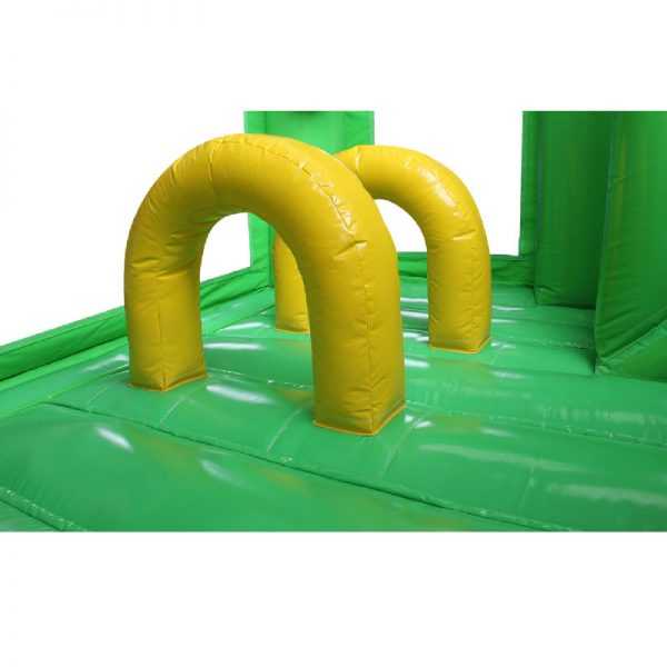 Green and yellow bouncy castle obstacles.