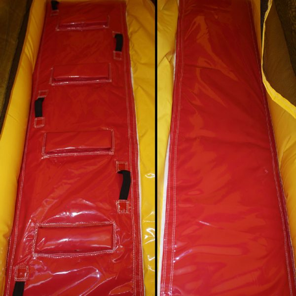 Closeup of a red and yellow bouncy castle climbing wall and a slide.
