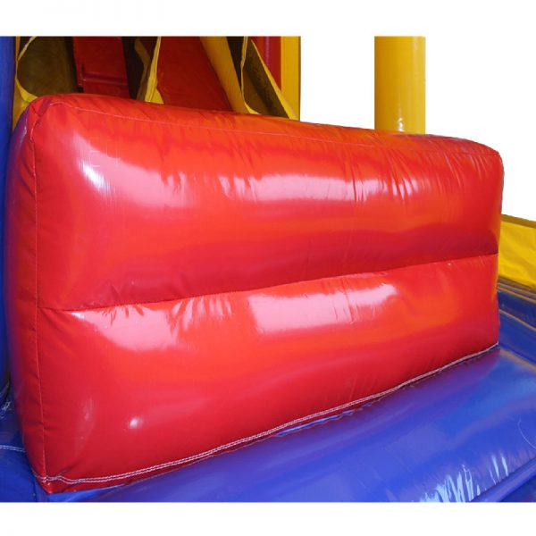 Red stop wall at the bottom of the inflatable slide.