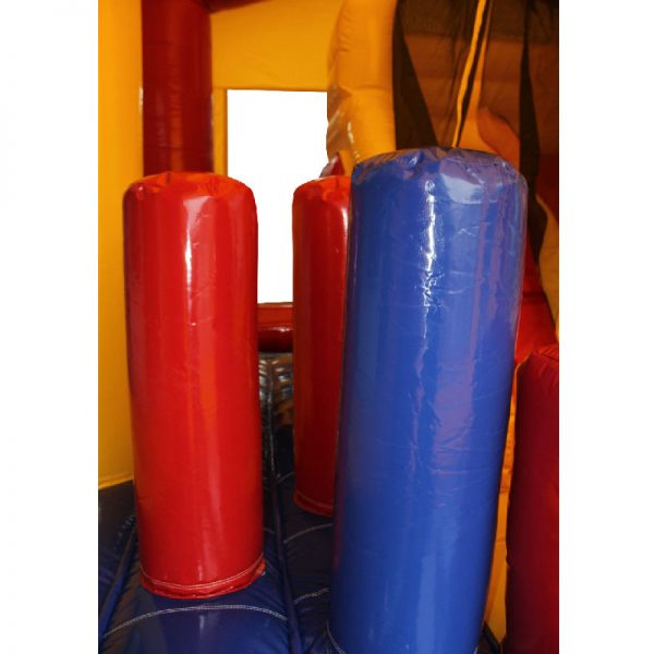 Red, yellow and blue bouncy castle obstacles.