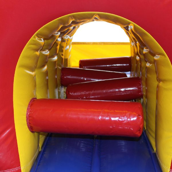Tunnel with obstacles inside of a bouncy castle.