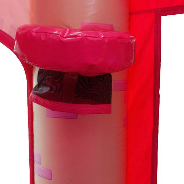 Bouncy castle basketball hoop with a black netting on the corner column of a pink bouncy castle.