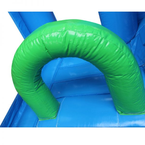 Green obstacle in a blue bouncy castle.