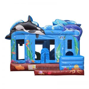 Sea themed inflatable bounce house featuring an Orca whale, dolphins and other sea creatures.