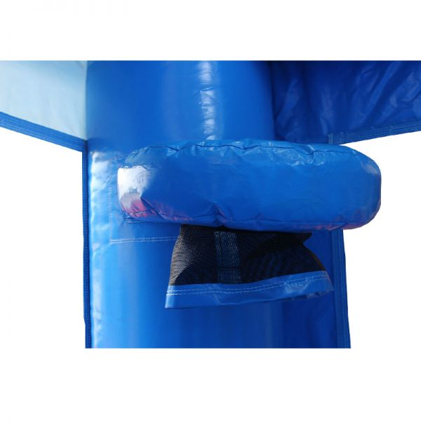 Bouncy castle basketball hoop with a black netting on the corner column of a blue bouncy castle.