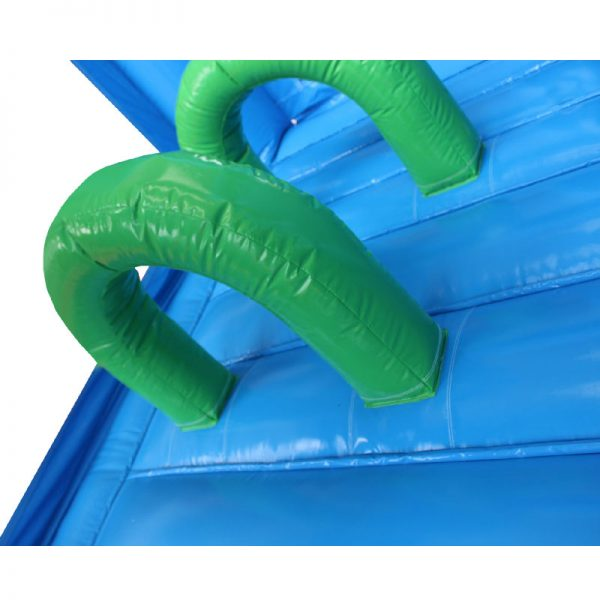 Green and blue bouncy castle obstacles.