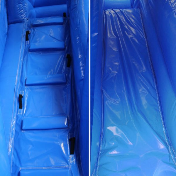Closeup of a blue bouncy castle climbing wall and a slide.