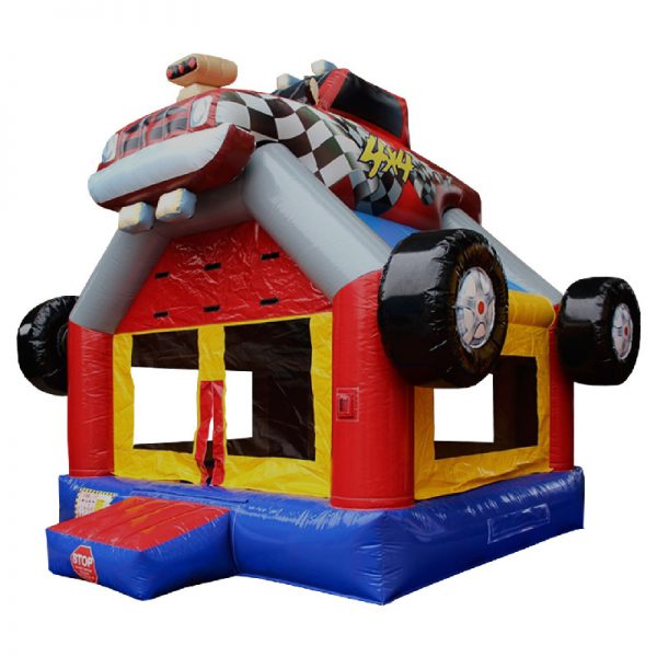 Blue red and yellow inflatable with a monster truck 3D design mounted on top.