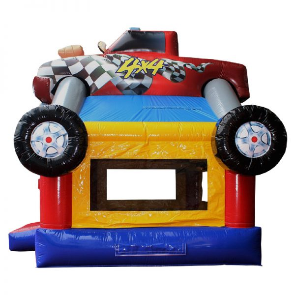 Monster Truck bounce house side view. Blue red and yellow inflatable with a monster truck 3D design mounted on top.