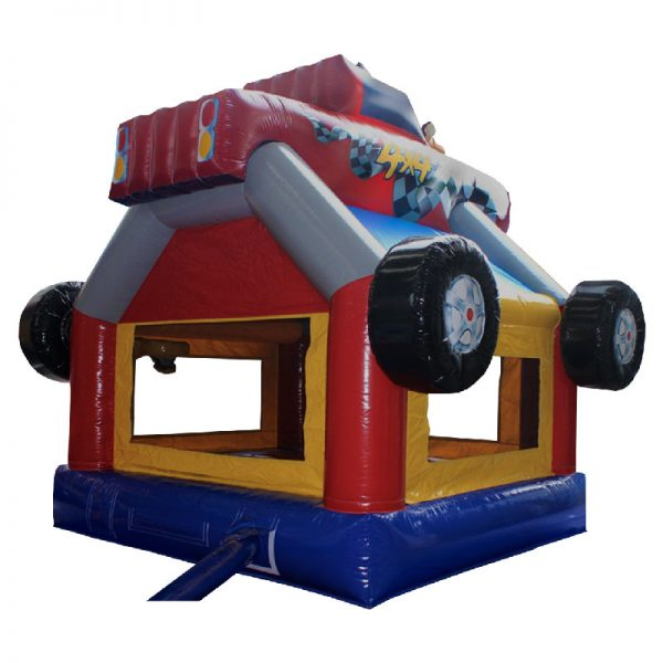 Monster Truck bounce house rear view. Blue red and yellow inflatable with a monster truck 3D design mounted on top.