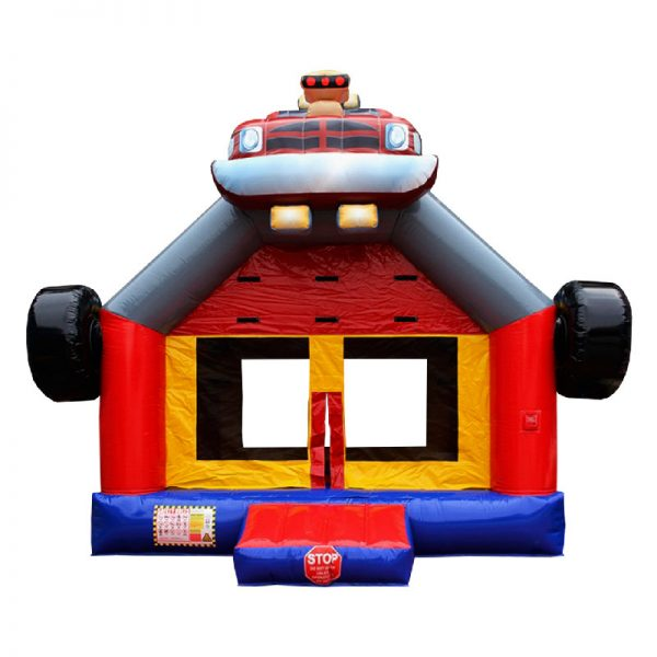 Monster Truck bounce house front view. Blue red and yellow inflatable with a monster truck 3D design mounted on top.