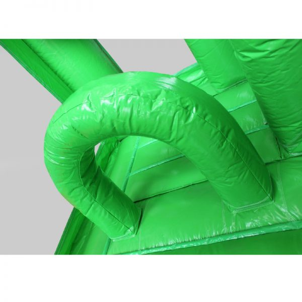 Green obstacle in a green bouncy castle.