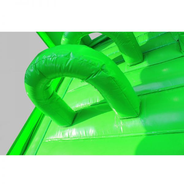 Green bouncy castle obstacles.