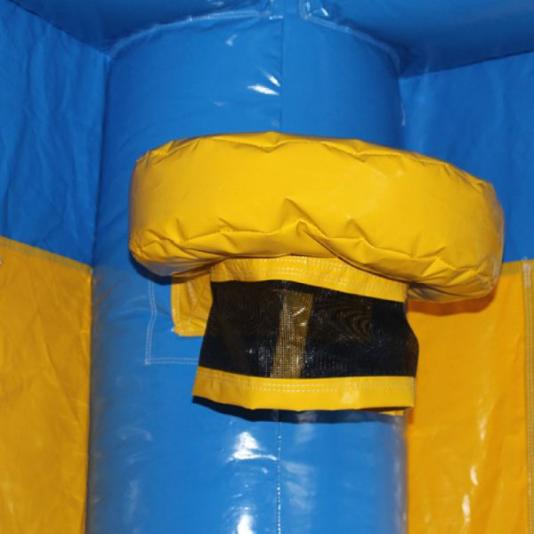 Yellow basketball hoop with a black netting on the corner column of a blue bouncy castle.